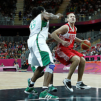 02 August 2012: Russia Anton Ponkrashov eyes the basket as Brazil Nene Hilario defends on him during 75-74 Team Russia victory over Team Brazil, during the men's basketball preliminary, at the Basketball Arena, in London, Great Britain.