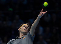 Tennis - 2019 Nitto ATP Finals at The O2 - Day One<br /> <br /> Singles Group Bjorn Borg: Roger Federer (Switzerland) vs. Dominic Thiem (Austria)<br /> <br /> Dominic Thiem (Austria) serving to take the first set <br /> <br /> COLORSPORT/DANIEL BEARHAM