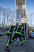 London Fire Brigade, station training session on the second floor of the tower. Fire fighter set up the ladders.