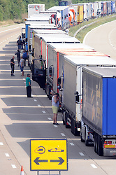 © Licensed to London News Pictures. 30/07/2015<br /> Lorries stacked up between J8 and J9 M20 (this afternoon 30.07.2015).coast bound.<br /> Traffic misery continues on the M20,  Operation Stack enters a third day - and will most likely remain in place into the weekend.<br /> A 23-mile stretch of the coast-bound carriageway is shut with part of the London-bound side also closed.<br /> <br /> <br /> (Byline:Grant Falvey/LNP)
