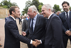 French National Assembly speaker Francois de Rugy and French Senate speaker Gerard Larcher with French President Emmanuel Macron attend a ceremony commemorating General Charles De Gaulle's June 1940 appeal for French resistance against Nazi Germany, at the Mont Valerien National Memorial in Suresnes on the outskirts of Paris on June 18, 2018. Photo by Eliot Blondet/ABACAPRESS.COM
