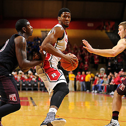 Kadeem Jack #11 of the Rutgers Scarlet Knights drives against Temple defenders during the second half of Rutgers men's basketball vs Temple Owls in American Athletic Conference play on Jan. 1, 2014 at Rutgers Louis Brown Athletic Center in Piscataway, New Jersey.
