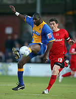 Photo: Rich Eaton.<br /> <br /> Shrewsbury Town v Milton Keynes Dons. Coca Cola League 2. Play off Semi Final, 1st Leg. 14/05/2007. Shrewsburys Leo Fortune-Wesr beats MK Dons Keith Andrews to the ball