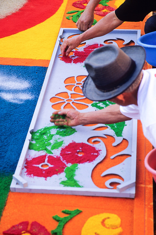 Guatemala, Antigua. Decorating streets with colored sawdust and stencils during Semana Santa Holy Week (Easter).