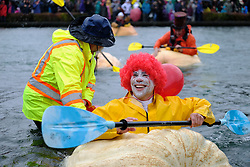 A man dressed as Ronald McDonald takes part in the 14th annual West Coast Giant Pumpkin Regatta in Tualatin, Ore. on October 21, 2017. (Photo by Alex Milan Tracy)