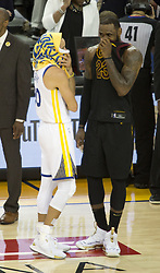 May 31, 2018 - Oakland, California, U.S - LeBron James #23 of the Cleveland  Cavaliers talks to  Stephen Curry #30 of the Golden State Warriors during their  NBA Championship Game 1 at Oracle Arena in Oakland,  California on Thursday,  May 31, 2018. ARMANDO  ARORIZO/PI (Credit Image: © Prensa Internacional via ZUMA Wire)