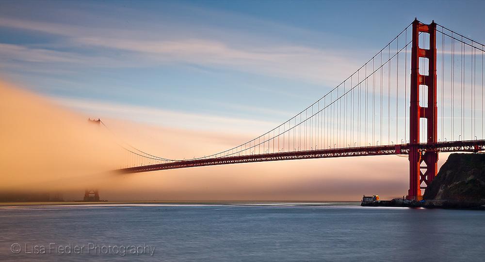 fog rolling in under the golden gate bridge near sunset san francisco california