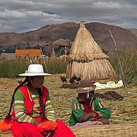 South America, Peru, Uros Islands. Uros women of the floating reed islands of Lake Titicaca.