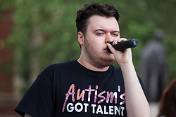 London, UK. 30 May, 2019. Macauley of Autism's Got Talent performs for campaigners from SEND National Crisis attending a demonstration in Parliament Square to demand improvements in the diagnosis and assessment of young people with SEND, assistance for their families, funding and legal and financial accountability for local authorities in their treatment of young people with SEND and their families. Credit: Mark Kerrison/Alamy Live News