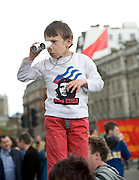 May Day march and rally at Trafalgar Square, May 1st, 2010 Child with binoculars wearing Viva Cuba Che Guevara shirt