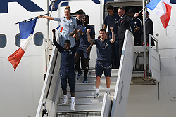 France's Antoine Griezmann and Ousmane Dembele rise their fists as they disembark from the plane with teammates upon their arrival at the Roissy-Charles de Gaulle airport on the outskirts of Paris, France, on July 16, 2018 after winning the Russia 2018 World Cup final football match. Photo by ABACAPRESS.COM