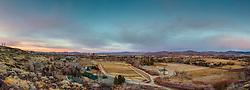 """""""Reno, Nevada Sunset 3"""" - Panoramic photograph of a Nevada shaped horse corral and Reno, Nevada shot at sunset."""