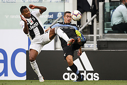 August 25, 2018 - Turin, Italy - Juventus defender Alex Sandro (12) fights for the ball against Lazio defender Adam Marusic (77) during the Serie A football match n.2 JUVENTUS - LAZIO on 25/08/2018 at the Allianz Stadium in Turin, Italy. (Credit Image: © Matteo Bottanelli/NurPhoto via ZUMA Press)