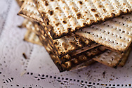 A stack of matzos or matzahs used in a Passover seder. WATERMARKS WILL NOT APPEAR ON PRINTS OR LICENSED IMAGES.