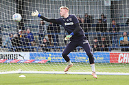 AFC Wimbledon goalkeeper Aaron Ramsdale (35) warming up during the EFL Sky Bet League 1 match between AFC Wimbledon and Doncaster Rovers at the Cherry Red Records Stadium, Kingston, England on 9 March 2019.