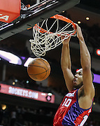 December 22, 2009; Houston, TX USA; Los Angeles Clippers guard Eric Gordon (10) dunks over Houston Rockets guard Shane Battier (31) in the second half at the Toyota Center. The Rockets won 108-99. Mandatory Credit: Thomas Campbell-US PRESSWIRE