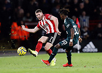 SHEFFIELD, ENGLAND - DECEMBER 05: <br /> Sheffield United's John Lundstram passes despite the attentions of Newcastle United's Christian Atsu<br /> during the Premier League match between Sheffield United and Newcastle United at Bramall Lane on December 5, 2019 in Sheffield, United Kingdom. (Photo by Rich Linley - CameraSport via Getty Images)