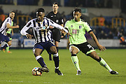 Millwall midfielder Fred Onyedinma (10) holding off Bournemouth Forward Lys Mousset (31) during the The FA Cup 3rd round match between Millwall and Bournemouth at The Den, London, England on 7 January 2017. Photo by Matthew Redman.