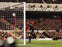 Fotball: Dennis Bergkamp, Arsenal, scores goal no.4 past the helpless Bayer Goalkeeper,Hans-Jorg Butt. Arsenal v Bayer Leverkusen. Champions League. 27.2.2002.<br /><br /> Foto : Andrew Cowie/Digitalsport