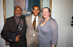 Centre, footballer THEO WALCOTT and his parents DONALD & LYNN WALCOTT at the opening of an exhibition entitled Exceptional Youth supported by Teen Vogue at the National Portrait Gallery, London on 3rd November 2006.<br /><br />NON EXCLUSIVE - WORLD RIGHTS