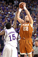 Texas forward Brad Buckman (22) scores over Kansas State's David Hoskins (15), during the first half at Bramlage Coliseum in Manhattan, Kansas, February 22, 2006.  The 7th ranked Longhorns held on for a 65-64 win over K-State.