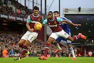 James Tomkins of West Ham United  and Diafra Sakho of West Ham United blocking the ball from Diego Costa of Chelsea. Barclays Premier League, West Ham Utd v Chelsea at The Boleyn Ground, Upton Park in London on Saturday 24th October 2015.<br /> pic by John Patrick Fletcher, Andrew Orchard sports photography.