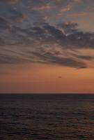 Orange colored sky and clouds over the Pacific Ocean just after sunrise. Image 2 of 10 for a wide-angle panorama taken with a Fuji X-T1 camera and 35 mm f/1.4 lens  (ISO 200, 35 mm, f/16, 1/250 sec). Raw images processed with Capture One Pro and stitched together with AutoPano Giga Pro.