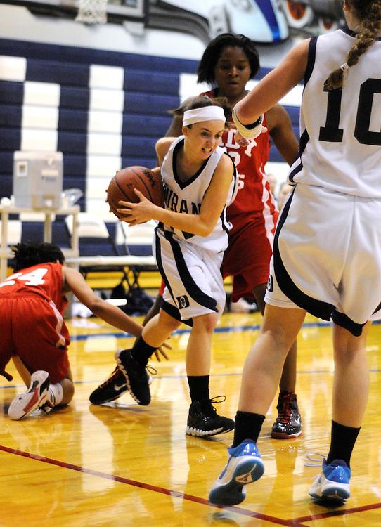 Matt Dixon   The Flint Journal..Durand's Jalynne Cunningham grabs the ball from Beecher defender Dynasty Washington (back left) in a high school basketball game, Thursday, Jan. 20.