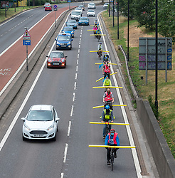 "© Licensed to London News Pictures; 03/06/2020; Bristol, UK. Protest group ""Space to Breathe"" cycle on Newfoundland Road, the main road out of central Bristol which later becomes the M32. The campaign say there is not enough space on Bristol's pavements, cycle lanes and shared paths to take exercise while maintaining social distancing during the Covid-19 coronavirus pandemic, and they aim to show how one lane of Newfoundland road could be used for socially distanced active travel as a cycle lane. The group want pop-up cycle lanes along all of Bristol's arterial roads and more space on Bristol's roads, pavements, cycle lanes and shared paths for active travel and for taking exercise while maintaining social distancing. The cyclists ride with 2m foam tubes attached to their bicycles to highlight the space they need to safely commute and exercise with social distancing, and to encourage vehicles overtaking to pass at a safe distance. The group say that while there is less traffic on the roads, there's plenty of space to make separate lanes for walking, running and cycling and that failure to implement safe space now would be like failure to act on providing PPE. The group say that Bristol City Council's current plans for making more room will be too little too late and that other cities have already implemented more road space for cyclists and pedestrians. Photo credit: Simon Chapman/LNP."