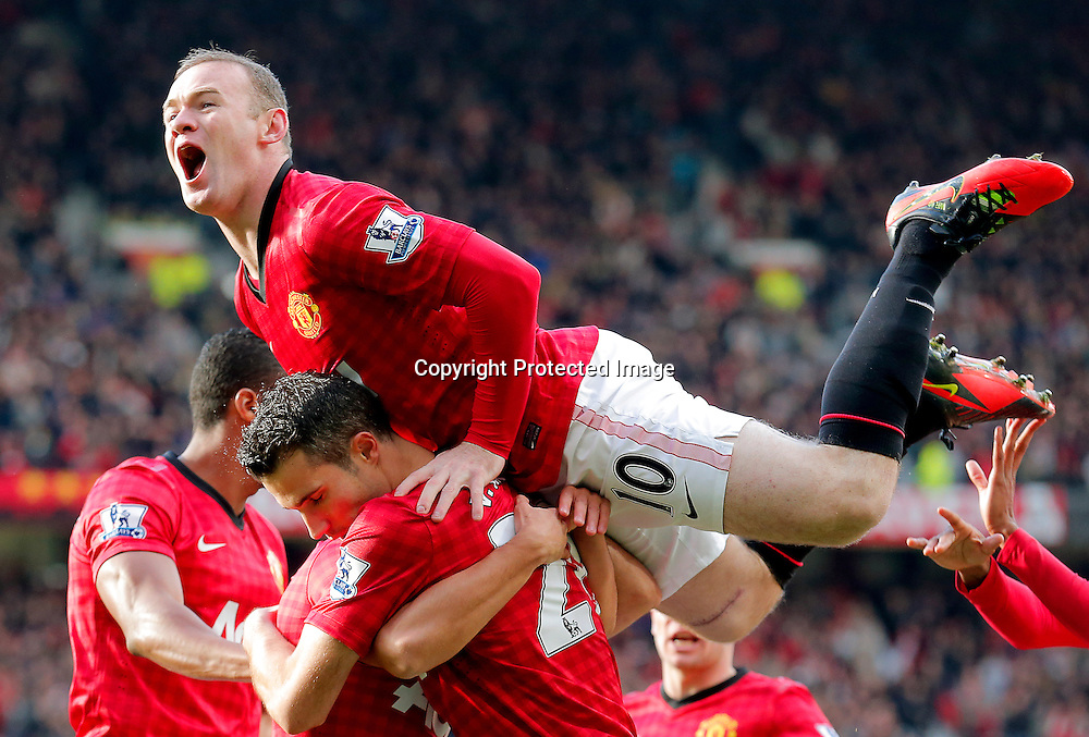 Robin van Persie (bottom) of Manchester United  celebrates with his teammate Wayne Rooney (top) after scoring against Arsenal during English Premier League soccer match between Manchester United and Arsenal at Old Trafford, Manchester, Britain, on 03 November 2012.  EPA/KERIM OKTEN DataCo terms and conditions apply. http//www.epa.eu/downloads/DataCo-TCs.pdf