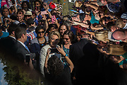 Democratic presidential candidate Hillary Clinton, seen reflected in a teleprompter, greets supporters after speaking at a rally at Pasco-Hernando State College East campus in Dade City, Florida, U.S., November 1, 2016.
