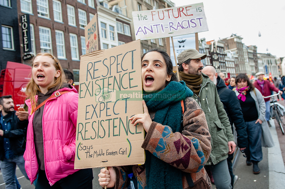 March 23, 2019 - Amsterdam, North Holland, Netherlands - March 23rd, Amsterdam. Thousands of people gathered this Saturday, at the Dam square in the center of Amsterdam during a demonstration against racism and discrimination. They ask for diversity and solidarity, against all forms of racism and discrimination. Also, against the two political far-right parties in The Netherlands, the PVV and the FvD which have increased their power during the last elections in the country. A small far-right group showed up during the walk holding two big placards and shouting to the demonstration. (Credit Image: © Romy Arroyo Fernandez/NurPhoto via ZUMA Press)
