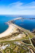 Nederland, Zeeland, Gemeente Schouwen-Duiveland, 01-04-2016; Brouwersdam, onderdeel van de Deltawerken, tussen Schouwen-Duiveland en Goeree (aan de horizon). Na het afsluiten van de zeearm Grevelingen is het Grevelingenmeer ontstaan, rechts van de dam, het grootste zoutwatermeer van West-Europa. Om de kwaliteit van het water in het meer te garanderen is er in de dam een inlaatwerk voor zout zeewater aangebracht (midden). Links de Noordzee, in het midden Middelplaat en recreatiecentrum en vakantiepark Port Zelande.  In de voorgrond Resort Land&Zee.<br /> <br /> Brouwers dam, part of the Delta Works, between Goeree and Schouwen-Duiveland (on the horizon). Closing the estuary resulted in the Grevelingen lake, the largest saltwater lake in Western Europe.<br /> <br /> luchtfoto (toeslag op standard tarieven);<br /> aerial photo (additional fee required);<br /> copyright foto/photo Siebe Swart