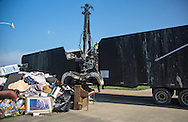 Sept. 2, 2016, Walker, Louisiana, Terry Dougan (on crane), a disaster cleanup worker from Arkansas, is one in an army of workers from around the country who came to the Baton Rouge area to help with the massive relief effort.