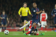 Laurent Koscielny of Arsenal tackles Lucas of Paris Saint-Germain. UEFA Champions league group A match, Arsenal v Paris Saint Germain at the Emirates Stadium in London on Wednesday 23rd November 2016.<br /> pic by John Patrick Fletcher, Andrew Orchard sports photography.