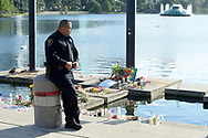 Eatonville Police Department officer Omar Delgado stands next to a makeshift memorial for victims of the Pulse nightclub shooting at Lake Eola Thursday, June 23, 2016, in Orlando, Fla. PHELAN M. EBENHACK FOR THE NEW YORK TIMES