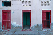 Red Door and two red windows