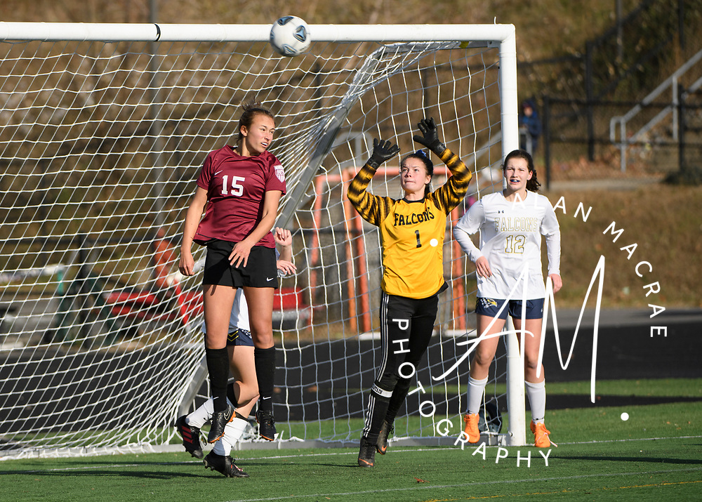 Hanover junior Sage McGinley-Smith tries to head the ball into the goal during the NHIAA Division II soccer championship in Manchester on Sunday, November 10, 2019.  (Alan MacRae/Valley News)