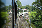 29 JULY 2007 -- INTERLAKEN, BERN, SWITZERLAND:  A passenger train comes down the Swiss Alps headed for the Interlaken Ost station in Interlaken. Interlaken, in the canton of Bern, is the center of the tourist industry in the Bernese Oberland.  Photo by Jack Kurtz