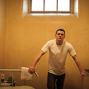 Starred Up 2013, publicity stills photographer  Aidan Monaghan<br /> Director: David Mackenzie Producer: Gillian Berrie    Writer: Jonathan Asser<br /> Cast: Jack O'Connell, Ben Mendelsohn, Rupert Friend<br /> Reviews:  Variety  Indiewire Collider<br /> Starred Up<br /> Synopsis: Eric (Jack O'Connell) is a violent young offender prematurely thrown into the dark world of an adult prison. As he struggles to assert himself against the prison officers and the other inmates, he has to confront his own father, Nev (Ben Mendelsohn); a man who has spent most of his life in jail. As Eric forges allegiances with other prisoners, he learns that his rage can be overcome and discovers the new rules of survival. But there are forces at work which threaten to destroy him.<br /> <br /> World Premiere: Toronto International Film Festival 2013<br /> <br /> UK Premiere: London Film Festival 2013<br /> <br /> publicity stills photographer for film & TV, Starred Up 2013,Jack O'Connell, Ben Mendelsohn, Rupert Friend, Director: David Mackenzie