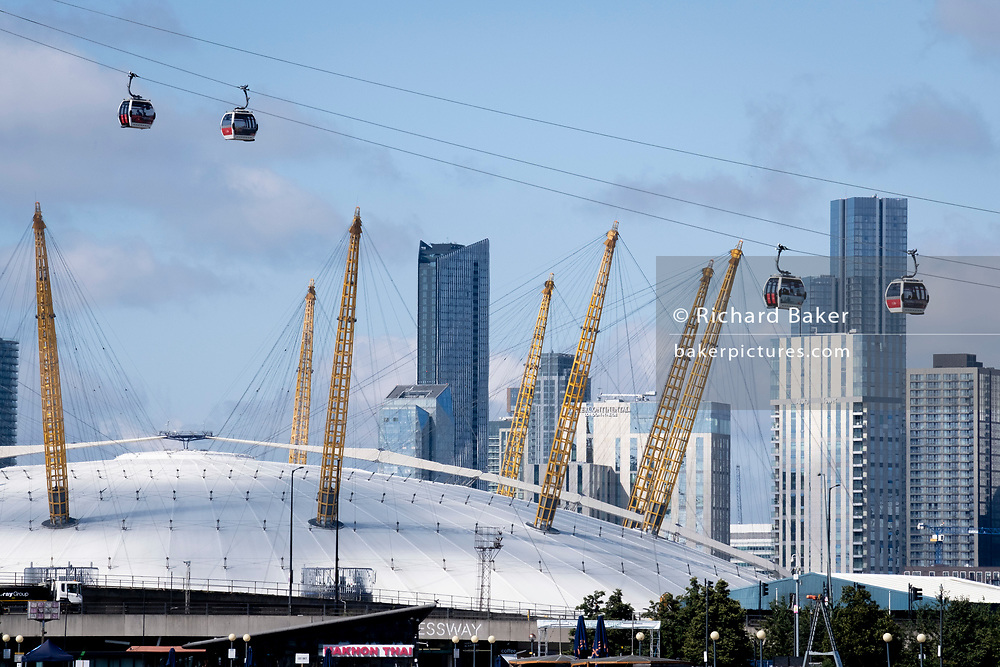 A view of Emirates Air Line cable cars and the O2 Arena on the Greenwich Peninsular, on 11th August 2021, in London, England.