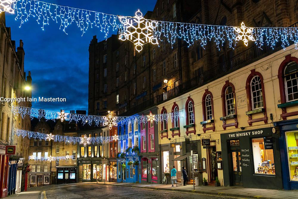 Edinburgh, Scotland, UK. 26 November 2020.Night views of Edinburgh as Christmas approaches.  View of Christmas lights in Victoria Street in Edinburgh's Old Town.  Credit.  Iain Masterton/Alamy Live News