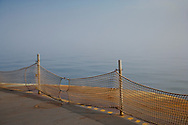 net barrier on the end of a Washington State Ferry car deck with fog beyond on a Puget Sound crossing