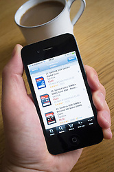 Using an iPhone 4G smart phone to buy electronics products from Amazon.com online shop