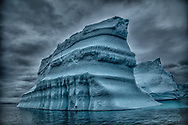 Towering and majestic iceberg lures your inner explorer to enter the old lost world. Giant icebergs convey the quintessential essence of Greenland and its forbidding environment.