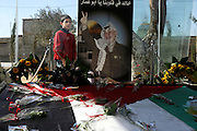 Palestinian boy looking through the glass surrounding the gravesite of former Palestinian leader Yasser Arafat at the Palestinian Authority (PA)headquarter, last residence and burial site of Yasser Arafat, in the Palestinian capital Ramallah, on Friday, Nov. 11, 2005. Here a mausoleum and a museum in his honour will be built soon. **ITALY OUT**