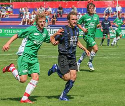 FODBOLD: Thomas Loran (NKF) foran Jacob Jensen og Dimitri de Martignac (Helsing¯r) under kampen i KvalifikationsrÊkken, pulje 1, mellem Elite 3000 Helsing¯r og NivÂ-Kokkedal FK den 6. august 2006 pHelsing¯r Stadion. Foto: Claus Birch