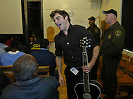 """Jaoquin Phoenix meets inmates at the California State Penitentiary, Folsom, California after a short concert of songs from his movie about the life of Johnny Cash, """"Walk The Line."""""""