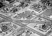 Ackroyd 02199-1. aerial NE 12th, Sandy and East Burnside. Portland Oregon. May 15, 1950. Motor City 3-Minit Car Wash, Rawlinson's Cleaners, Tik-Tok drive-in. view looking northwest.