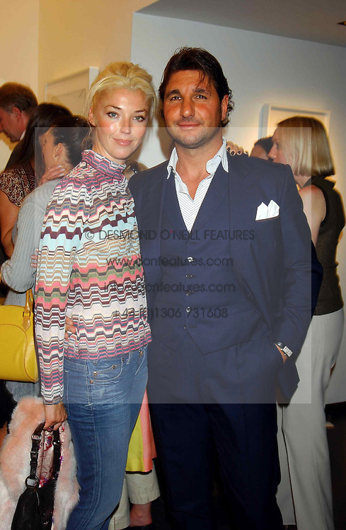MISS TAMARA BECKWITH and MR GEORGE VERONI at a party to celebrate the opening of an exhibition of photographs by the late Norman Parkinson held at Hamiltons gallery, 13 Carlos Place, London W1 on 14th September 2004.<br /><br />NON EXCLUSIVE - WORLD RIGHTS